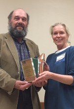 Laurie Pyne accepting the copper smoker from outgoing President Mark Emrich